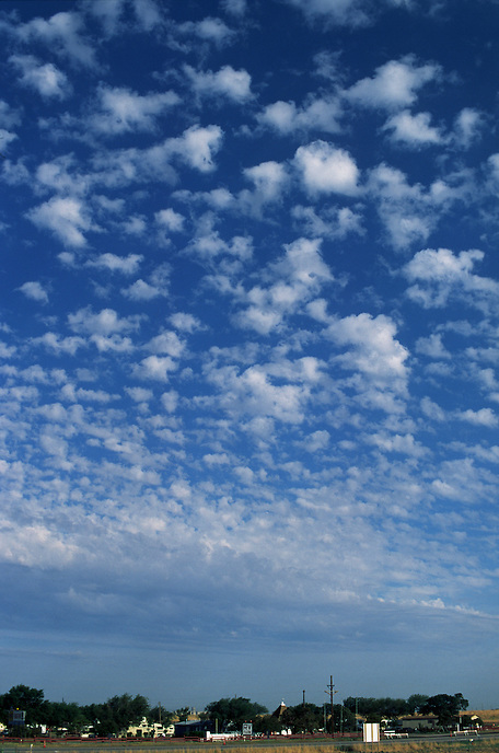 Altocumulus Castellanus (accas) clouds pepper the morning sky over Amarillo Texas. Clouds such as these can be an indicator of relatively high mid-level instability which may be a precursor to thunderstorm activity later in the day.