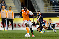 Fabio Alves (Fabinho) (33) of the Philadelphia Union goes for a tackle on Warren Creavalle (5) of the Houston Dynamo. The Houston Dynamo defeated the Philadelphia Union 1-0 during a Major League Soccer (MLS) match at PPL Park in Chester, PA, on September 14, 2013.