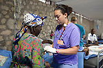 Project HOPE volunteer nurse Nora Sheehan removes the I.V. from a cholera patient who is healthy enough to return home at the Hospital Albert Schweitzer on Thursday, October 28, 2010 in Deschapelles, Haiti.