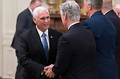 United States Vice President Mike Pence greets guests as he arrives to listen to a news conference with US President Donald J. Trump and President Sauli Niinisto of Finland in the East Room of the White House in Washington, DC on Wednesday, October 2, 2019. <br /> Credit: Chris Kleponis / Pool via CNP