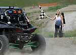 STURGIS, SD - JUNE 13: Allex Nelson of Billings, MT waves the checkered flag as the UTV class finishes at the Liberty Superstores/Dakota-Customs 250 short course baja race at the Buffalo Chip.  (Photo by Dick Carlson/Inertia)
