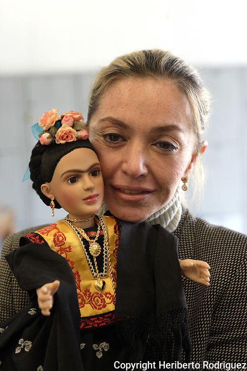 Cristina Dorsett cradles a Frida Khalo collection doll is displayed in this pictures as is annouced to be launched in Mexico City on December 14. The 20-inch Frida Khalo doll is clad in a traditional Mexican dress. Miss Dorsett is the owner of the doll factory where they were made. Frida Khalo Corporation, leaded by Frida's niece Isolda Khalo, has marketed Frida Kahlo jewellery and clothing after winning the rights to register the name as a brand. Photo by Heriberto Rodriguez