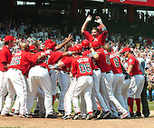 Washington, D.C. - June 18, 2006 --  Washington Nationals third baseman Ryan Zimmerman (11) loses his helmet as he leaps into the arms of his teammates after hitting the game-winning 2 run homer against the New York Yankees at RFK Stadium in Washington, D.C. on June 18, 2006.  The Nationals won the game 3 - 2..Credit: Ron Sachs / CNP