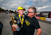 Sep 29, 2019; Madison, IL, USA; NHRA pro stock motorcycle rider Karen Stoffer celebrates with crew after winning the Midwest Nationals at World Wide Technology Raceway. Mandatory Credit: Mark J. Rebilas-USA TODAY Sports