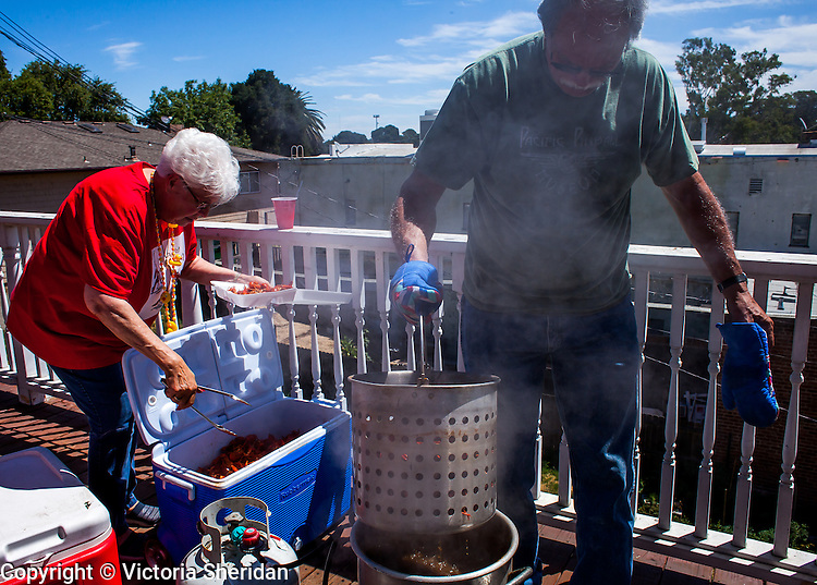 A jovial crowd assembled at Peter's Steakhouse in Isleton, California on Saturday, June 18, 2016 for the Tardy Mardi Party which featured, buckets of fresh cooked  crawdads, Louisiana cooking provided by  Catering by Le'Roy, and the very popular crawdad eating contest.  Photo/Victoria Sheridan 2016