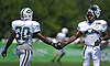 Lucky Whitehead #8, right, slaps hands with Romar Morris #30 during New York Jets Training Camp at the Atlantic Health Jets Training Center in Florham Park, NJ on Thursday, Aug. 3, 2017.