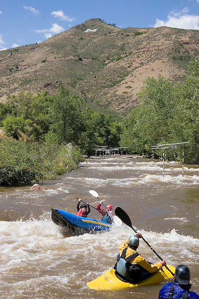 Kayaker and rafter on Clear Creek, with Lookout Mountain, Golden, Colorado. John offers private photo tours of Denver, Boulder and Rocky Mountain National Park. .  John offers private photo tours in Denver, Boulder and throughout Colorado. Year-round.