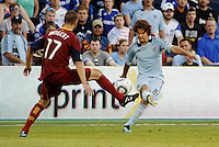 Graham Zusi (pale blue) Sporting KC gets a cross in despite the efforts of Real Salt Lake defender Chris Wingert... Sporting KC defeated Real Salt Lake 2-0 at LIVESTRONG Sporting Park, Kansas City, Kansas.