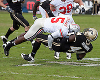 Ohio State defensive back Chimdi Chekwa puts a hit on Purdue running back Frank Halliburton. The Purdue Boilermakers defeated the Ohio State Buckeyes 26-18 at Ross-Ade Stadium, West Lafayette, Indiana on October 17, 2009..