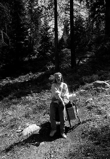 Laura Nelson with cart hiking to Sword Lake.<br />