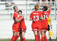Boyds MD - April 13, 2014: Christine Nairn (7) of the Washington Spirit celebrates her score with teammates. The Western New York Flash defeated the Washington Spirit 3-1 in the opening game of the 2014 season of the National Women's Soccer League at the Maryland SoccerPlex.