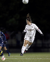 "Boston College forward Jill MacNeil (15) heads the ball. Boston College defeated West Virginia, 4-0, in NCAA tournament ""Sweet 16"" match at Newton Soccer Field, Newton, MA."