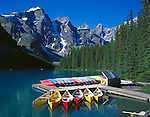 Banff National Park, Alberta, Canada    <br /> Canoes on Moraine Lake under the towering Wenkchemna Peaks