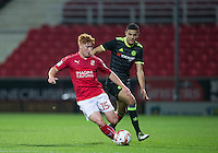 Tom Smith of Swindon Town turns Isaac Christie Davies of Chelsea during the The Checkatrade Trophy match between Swindon Town and Chelsea U23 at the County Ground, Swindon, England on 13 September 2016. Photo by Andy Rowland.