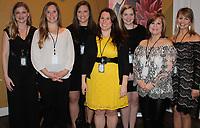 NWA Democrat-Gazette/CARIN SCHOPPMEYER Bridget Baird (from left), Terra Lewis, Elizabeth Kyle, Darci Burch, Alexandra Lange, Patti Barker and Channing Barker welcome guests to Havenwood's Journey Gala.