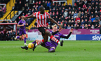 Lincoln City's John Akinde is tackled by Grimsby Town's Ludvig Ohman<br /> <br /> Photographer Chris Vaughan/CameraSport<br /> <br /> The EFL Sky Bet League Two - Lincoln City v Grimsby Town - Saturday 19 January 2019 - Sincil Bank - Lincoln<br /> <br /> World Copyright © 2019 CameraSport. All rights reserved. 43 Linden Ave. Countesthorpe. Leicester. England. LE8 5PG - Tel: +44 (0) 116 277 4147 - admin@camerasport.com - www.camerasport.com