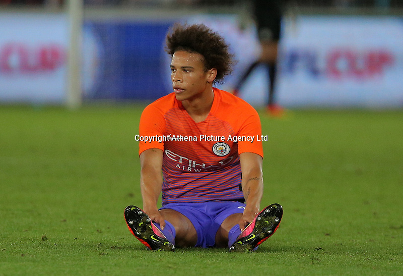 Leroy Sane of Manchester City sits on the ground after being fouled during the EFL Cup Third Round match between Swansea City and Manchester City at The Liberty Stadium in Swansea, Wales, UK. Wednesday 21 September.