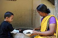 BANGLADESH Madhupur, support of Garo people with microcredits and agricultural training for income generation, Garo is indigenous people and are Christians, woman with vermi compost / Bangladesh, Region Madhupur, Unterstuetzung von Garo Familien mit Kleinkrediten und Trainingsprogrammen zur Existenzsicherung , Garos sind eine christliche u. ethnische Minderheit , Garo Frau Kalpona Ritchil im Dorf Idilpur mit Vermi-Kompost, den sie in ihrem Garten nutzt und auch zur Erzielung von Einkommen verkauft