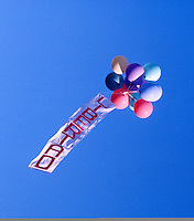A bunch of helium filled balloons, trailing a banner that reads: 'LIBERTAD' (freedom), rises into the bright blue sky above a demonstration (out of picture) calling for a 'No' vote in the 1988 referendum that asked the people to choose either 'Yes' for a continuation of Pinochet's rule or 'No' for him to leave office.