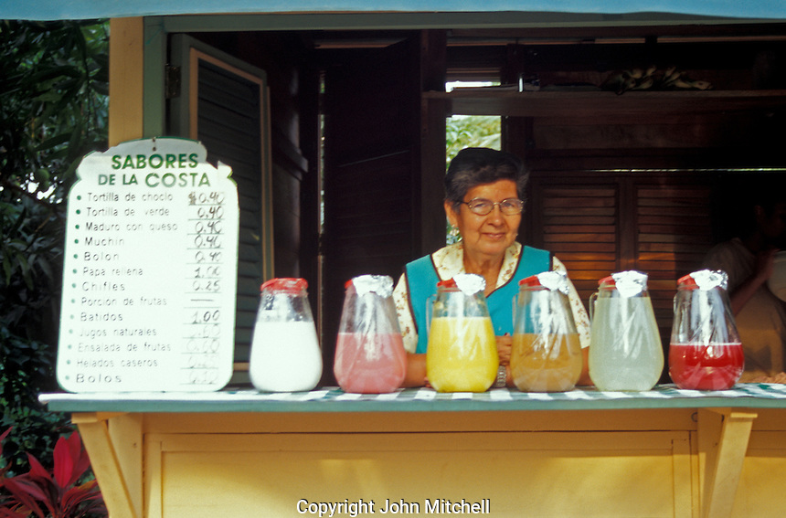 Woman selling tropical fruit juices or aguas frescas and snacks in the Parque Historico, Guayaquil, Ecuador