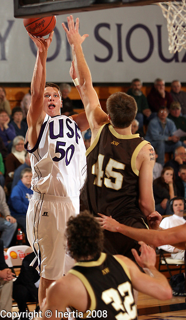 SIOUX FALLS, SD - DECEMBER 30:  Skyler Bloch #50 of the University of Sioux Falls shoots a jumper over Kevin Smith #45 of Southwest Minnesota State University in the first half of their game Tuesday night at the Stewart Center. (Photo by Dave Eggen/Inertia)