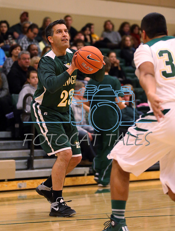 Nevada Gov. Brian Sandoval competes in the alumni game at the Wild West Shootout at Bishop Manogue High School in Reno, Nev., on Wednesday, Dec. 4, 2013. The Miners defeated the alumni 79-62. <br /> Photo by Cathleen Allison
