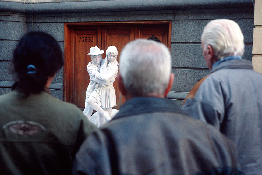 Street performers charm a crowd of downtown Buenos Aires strollers with mimicry of statues.