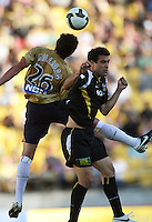 Newcastle's Mark Milligan beats Daniel to a header during the A-League match between Wellington Phoenix and Newcastle Jets at Westpac Stadium, Wellington, New Zealand on Sunday, 4 January 2009. Photo: Dave Lintott / lintottphoto.co.nz