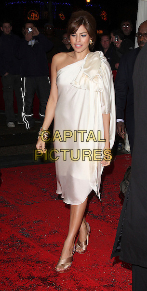 EVA MENDES .British Comedy Awards at the London ITV Studios, South Bank, London, England, December 6th 2008..full length cream white bow one shoulder silk dress gold bracelets  beige shoes .CAP/ROS.©Steve Ross/Capital Pictures