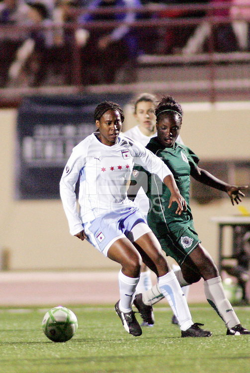 Ifeoma Dieke (white),shield the ball from Eniola Aluko..Saint Louis Athletica were defeated 1-0 by Chicago Red Stars.