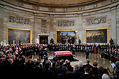 Vice President Mike Pence, right, speaks at the podium during services for former President George H.W. Bush at the Capitol in Washington, Monday, Dec. 3, 2018. (AP Photo/Pablo Martinez Monsivais/Pool)