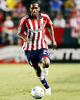 Chivas USA forward, Atiba Harris(24) moves the ball upfield during the 2nd half. Chivas USA  took on the NY Red Bulls on June 28, 2008 at the Home Depot Center in Carson, CA. The game ended in a 1-1 tie.