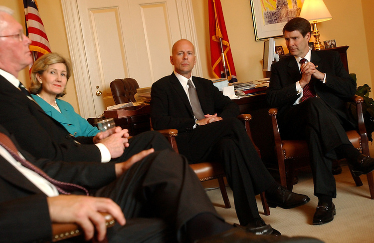"willis2/061103 - Actor Bruce Willis meets with Sen. Bill Frist, R-Tenn., right, Kay Bailey Hutchison, R-Texas, and Jim Bunning, R-Ky., in the Majority Leader's office before a news conference to promote a congressional call to Action on ""Foster Care Reform in the United States."""