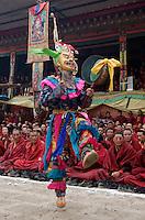 Masked dancer with skulls representing impermanence at the Cham dances, Katok Monastery - Kham, (Tibet), Sichuan, China