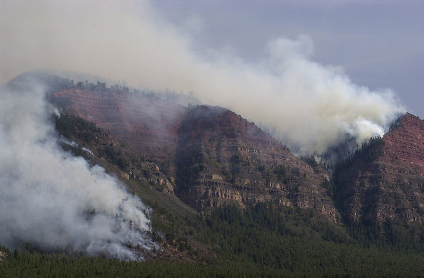 The Missionary Ridge Fire burns north of Durango, Colorado in June, 2002.