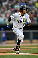 Second baseman Luis Carpio (18) of the Columbia Fireflies runs toward first in a game against the Lakewood BlueClaws on Friday, May 5, 2017, at Spirit Communications Park in Columbia, South Carolina. Lakewood won, 12-2. (Tom Priddy/Four Seam Images)