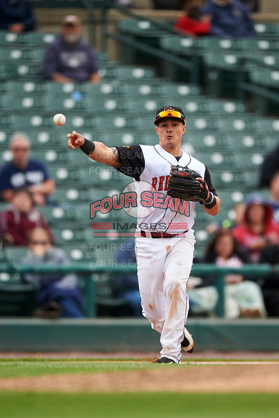 Rochester Red Wings third baseman Tommy Field (59) throws to first during a game against the Toledo Mudhens on June 12, 2016 at Frontier Field in Rochester, New York.  Rochester defeated Toledo 9-7.  (Mike Janes/Four Seam Images)