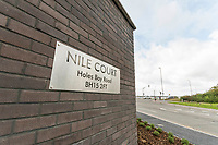 BNPS.co.uk (01202 558833)<br /> Pic: Graham Hunt/BNPS<br /> <br /> Flats at Nile Court overlooking Holes Bay at Poole in Dorset.<br /> <br /> Nile Court sign on the entrace to the flats.<br /> <br /> Are these Britain's most sought-after council flats ...<br /> <br /> A brand new block of council flats have been unveiled that come with stunning sea views homeowners pay a premium for.<br /> <br /> Nile Court is a development of one and two bedroom apartments overlooking Poole Harbour in Dorset, one of the most exclusive locations for property in the country.<br /> <br /> The flats have private balconies from which breathtaking sunset views over water can be enjoyed.<br /> <br /> Thirty out of the 46 flats in the nine storey building are only available to tenants registered for council accommodation, with monthly rents of around £270.