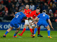28th December 2019; Thomond Park, Limerick, Munster, Ireland; Guinness Pro 14 Rugby, Munster versus Leinster; Billy Holland (C) of Munster takes the ball into contact Andrew Porter and Caelan Doris of Leinster - Editorial Use