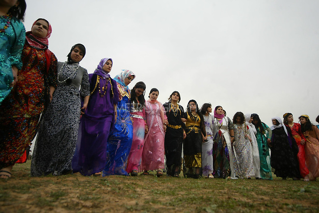 ERBIL, IRAQ: Kurdish women dance in a line at a wedding ceremony...Images from a traditional Kurdish wedding in Iraqi Kurdistan...Photo by Safin Hamid
