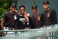 GCL Orioles Moises Nolasco, Samy Apolinar, Yeancarlos Lleras, and Jayvien Sandridge (L-R) during a Gulf Coast League game against the GCL Braves on August 5, 2019 at Ed Smith Stadium in Sarasota, Florida.  GCL Orioles defeated the GCL Braves 4-3 in the second game of a doubleheader.  (Mike Janes/Four Seam Images)