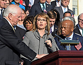 Former United States Representative Gabrielle Giffords (Democrat of Arizona) makes remarks as US House Democrats appear on the East Steps of the US Capitol to make a statement against gun violence in the wake of the Las Vegas Massacre in Washington, DC on Wednesday, October 4, 2017.  Looking on from left is US Representative Mike Thompson (Democrat of California), left, and US Representative John Lewis (Democrat of Georgia), right.<br /> Credit: Ron Sachs / CNP