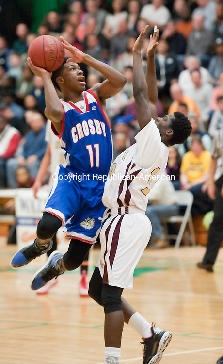 WATERBURY,  CT-030415JS06- Crosby's Jeremiah Kendall (11) puts up a shot over Sacred Heart's Raheem Solomon (14) during their NVL Tournament championship game Wednesday at Wilby High School in Waterbury. <br /> Jim Shannon Republican-American