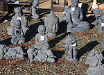 Ornamental Buddhist themed products on sale in a garden centre, UK