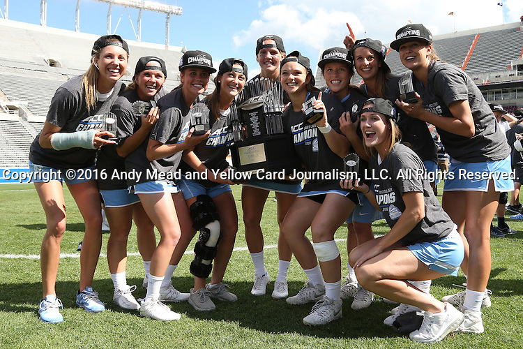 01 May 2016: UNC's juniors pose with the championship trophy. The University of North Carolina Tar Heels played the Syracuse University Orange at Lane Stadium in Blacksburg, Virginia in the 2016 Atlantic Coast Conference Women's Lacrosse Tournament championship match. North Carolina won 15-14 in overtime.