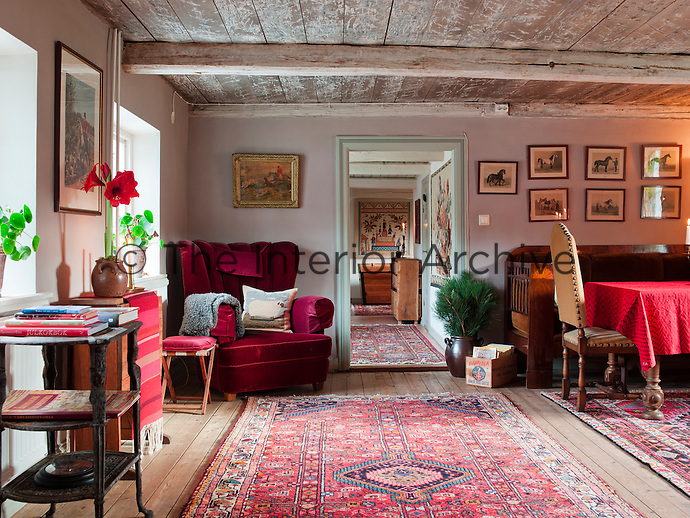 The antique prints above the sofa in the library represent various breeds of horses