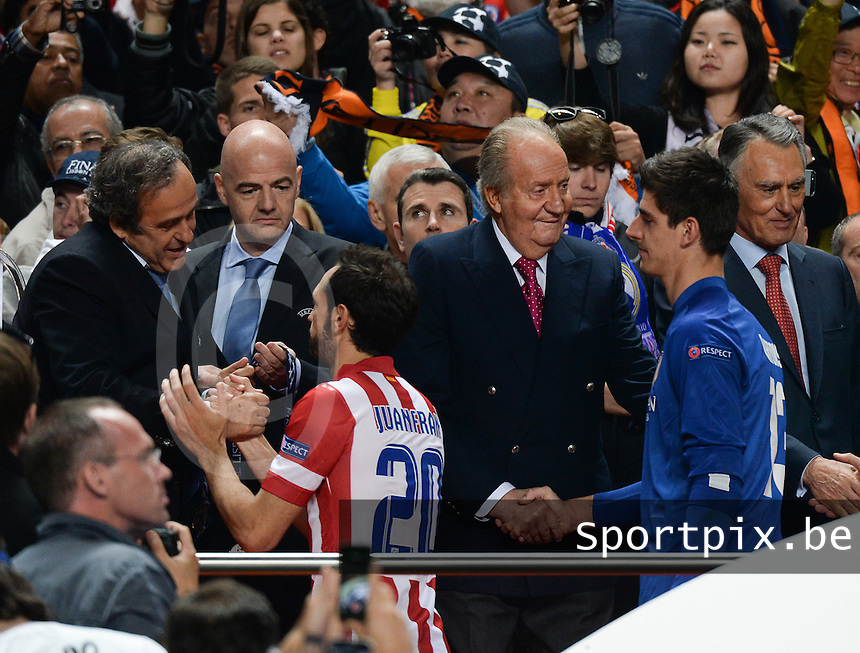 20140524 - LISBON , PORTUGAL : Michel Platini , Juanfran , spanish king Juan Carlos and Thibaut Courtois  pictured during soccer match between Real Madrid CF and Club Atletico de Madrid in the UEFA Champions League Final on Saturday 24 May 2014 in Estadio Da Luz in Lisbon .  PHOTO DAVID CATRY