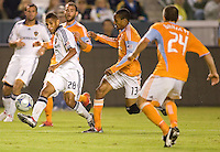 LA Galaxy defender Sean Franklin sends a ball over the middle past Houston's Ricardo Clark during the Western Conference Final. The LA Galaxy defeated the Houston Dynamo 2-1 to win the MLS Western Conference Final at Home Depot Center stadium in Carson, California on Friday November 13, 2009.....