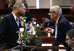 Nevada Senate Democrats Aaron Ford, left, and Mo Denis work on the Senate floor at the Legislative Building in Carson City, Nev., on Thursday, Feb. 5, 2015. <br /> Photo by Cathleen Allison