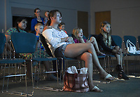NWA Democrat-Gazette/CHARLIE KAIJO Samantha McLeod of Lowell watches Wall-E with daughters Motley McLeod, 5 and Lexi McLeod, 8, (from foreground left) during a public movie screening, Tuesday, July 9, 2019 at the Rogers Public Library in Rogers. <br /> <br /> The library will host movie screenings every Monday at 1pm for the remainder of July.